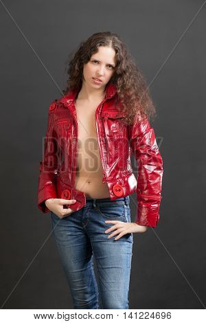portrait of a slender woman in a red jacket