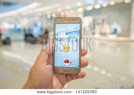 Bangkok Thailand - August 4 2016 : Charmander was found at shopping mall in Pokemon Go a new augmented reality game which lets you walk in the real world to catch the Pokemon.