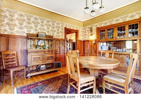 Open Floor Plan Antique Dining Area With Wooden Panel Trim