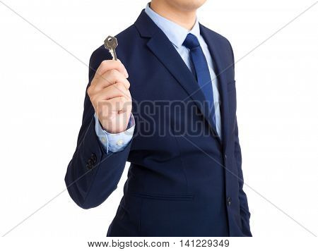 Businessman showing home key