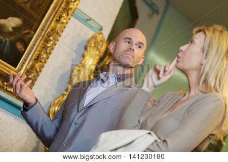an art seller meets with a client at home