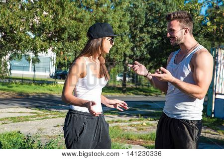 Young couple talking and chatting in a urban environment.