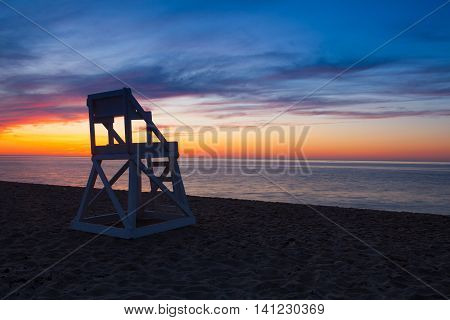 Watchtower and amazing sunset on the empty beach Cape Cod USA
