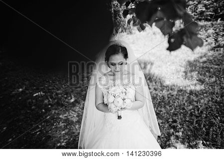 Portrait Of Cute Bride With Peony Wedding Bouquet At Hands At Wood, B&w Photo