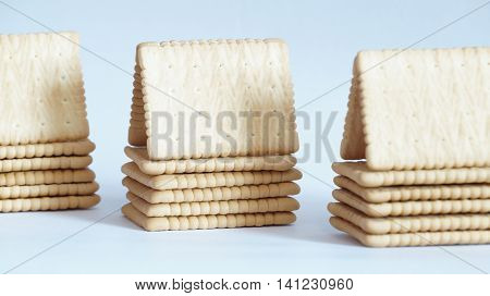 Houses made from crackers. Crackers are isolated on a white background.