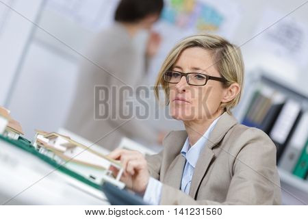 agent looking at a new-build property model