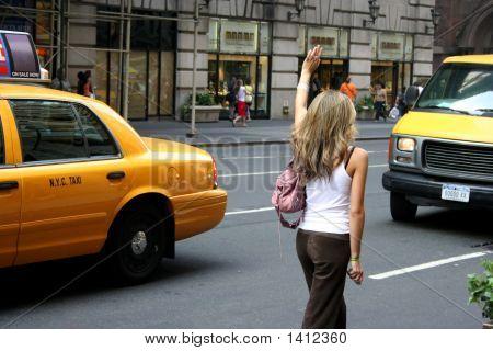Woman Hailing New York Cab / Taxi