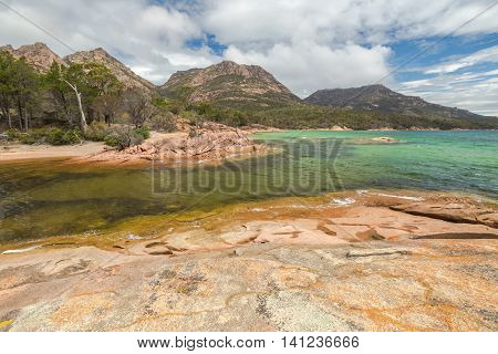 Honeymoon Bay is located near Coles Bay in Freycinet Peninsula. Freycinet National Park, is a paradise of pink granite mountains, white beaches and turquoise sea on Tasmanias east coast, Australia.