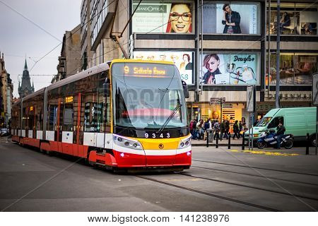 PRAGUE CZECH REPUBLIC - MARCH 5 2016: Modern excursion tram number 9 parade goes on old town in Prague. on March 5 2016
