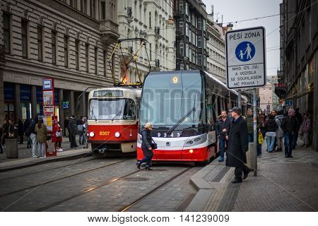 PRAGUE CZECH REPUBLIC - MARCH 5 2016: The vintage excursion tram number 14 and modern tram number 9 parade are goes on old town in Prague. on March 5 2016