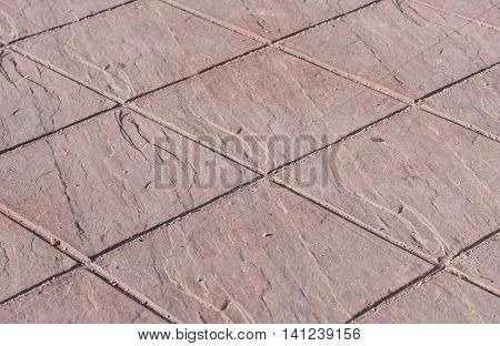 Stamped concrete floor outdoor pavement red square pattern detail