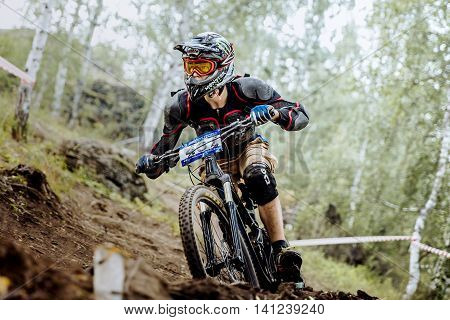 Magnitogorsk Russia - July 23 2016: closeup of male extreme racer bike during National championship downhill