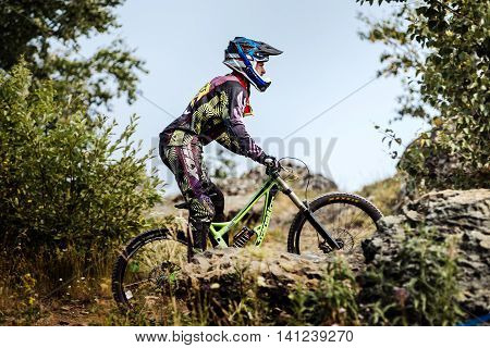 Magnitogorsk Russia - July 23 2016: closeup extreme athlete racer bike during National championship downhill