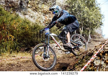 Magnitogorsk Russia - July 23 2016: down hill men athlete bike during National championship downhill