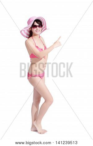 beauty woman wear bikini and pointing somewhere happily with isolated white background asian