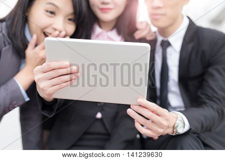businesspeople are looking tablet and meeting in hongkong asian