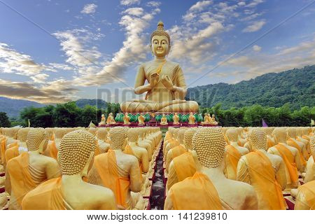 Buddha statue with sky and mountain at Buddha Maka Bucha park temple Nakohn Nayok Thailand