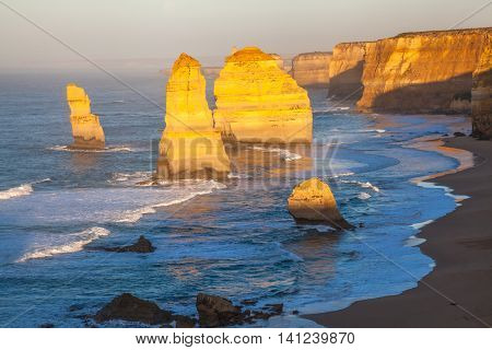 Closeup of the rock stacks that comprise the Twelve Apostles at sunset in Port Campbell National Park. Great Ocean Road, Victoria State, Australia.