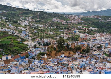 Awesome view over the blue painted city Chefchaouen in Morocco. In the middle you can see the historical Kashbah.