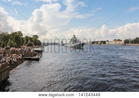 St. Petersburg, Russia - 31 July, Spectators parade on the promenade, 31 July, 2016. Festive parade of warships on the Neva River in St. Petersburg.