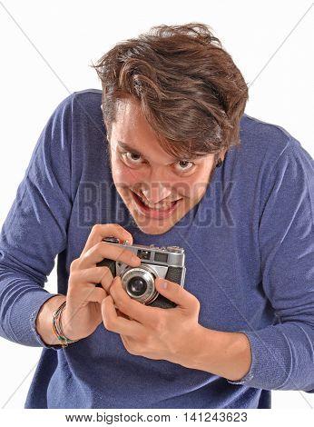 Bad paparazzi,crazy photographer portrait holding camera.