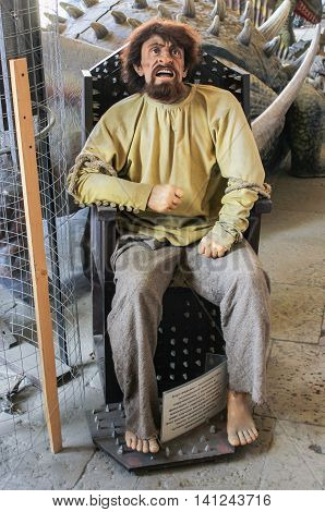 St. Petersburg, Russia - 9 April, Human figure in the chair of torture, 9 April, 2016. Wax Museum Gallery large Gostiny Dvor.