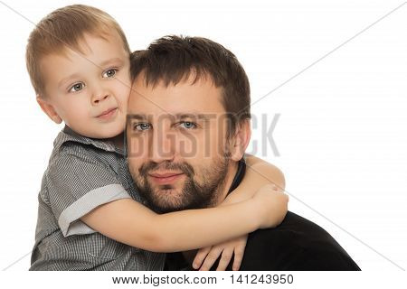 Cute little boy hugging the head of her beloved dad . close-up - Isolated on white background