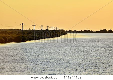 Sulina branch of the Danube river in Romania at sunset