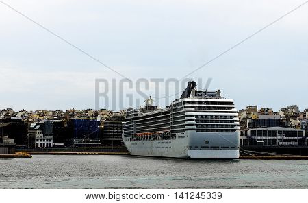 big cruise ship in the port of Greece near Athens