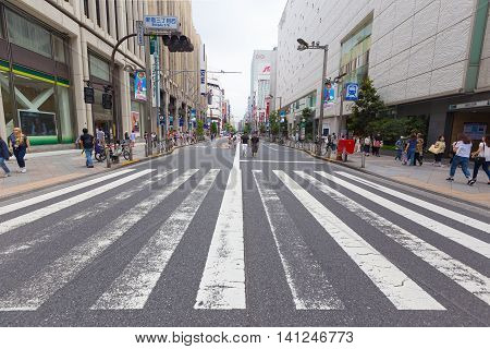 TOKYO JAPAN - 17 JULY 2016 - A street section in Shinjuku is blocked off from traffic on Sunday July 17 2016 for pedestrian to enjoy the day.