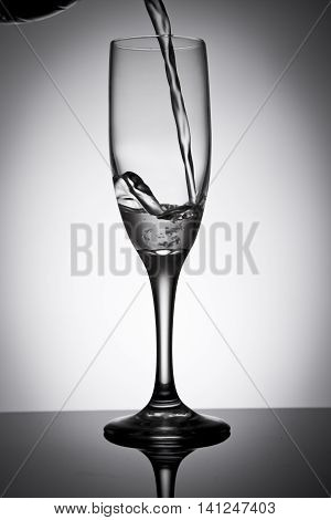 serving water in a glass with an abstract background
