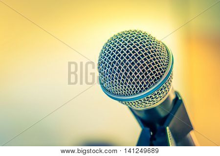 Black microphone in conference room ( Filtered image processed vintage effect. )