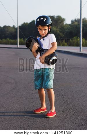 Boy Stands With Black Gyro Scooter Outdoors