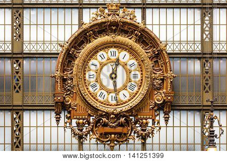 Paris France - Jule 08 2016: Golden clock of the museum D'Orsay.The Musee d'Orsay is a museum in Paris on the left bank of the Seine. Musee d'Orsay has the largest collection of impressionist and post-impressionist paintings in the world.
