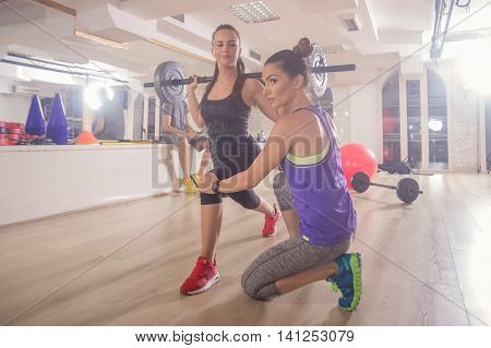 Fitness Instructor Two People Women Showing Correcting Lunge Weights Gym