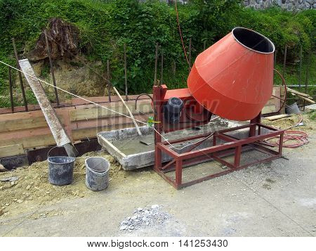 Preparation of the solution using a concrete mixer on a small construction site