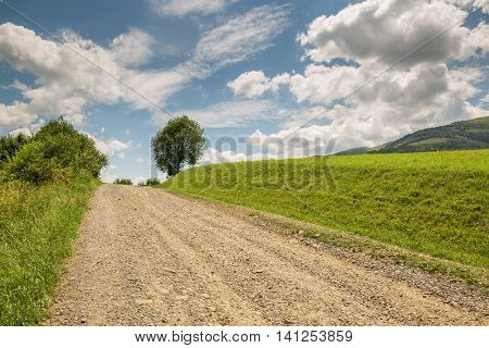 Road With Gravel Stretches Up The Hill