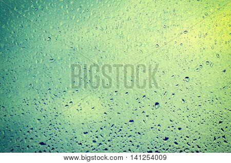 Rainy wet cold blue sky eco seasonal vintage natural background with water drops