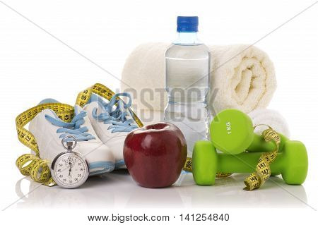 fitness equipment isolated on white. towel, two green dumbbells, shoes, ball, stopwatch and bottle of water.