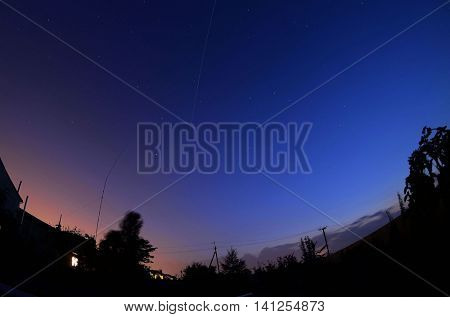 The ISS crossing by over the evening sky just after dawn in the Ukraine.