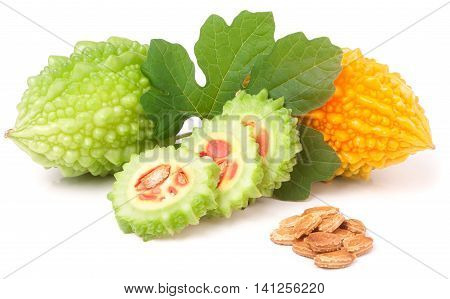 green and yellow momordica or karela with leaf and seeds isolated on white background.