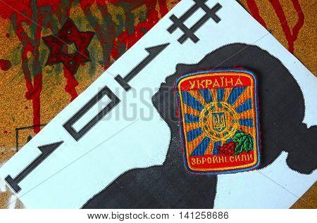 ILLUSTRATIVE EDITORIAL.Chevron of Ukrainian army.Ukraine kill 101 kids of Donbass.Civil War in Ukraine.July 30 ,2016 in Kiev, Ukraine