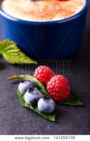 Red And Blue Berries On Slate Stone