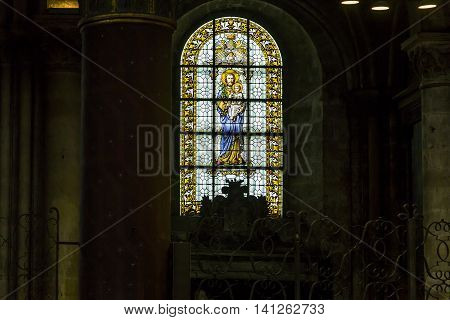 PARIS, FRANCE - MAY 12, 2015: This is stained glass of the church of Saint-Germain des Pres which is one of the oldest churches in France (founded in the 6th century).