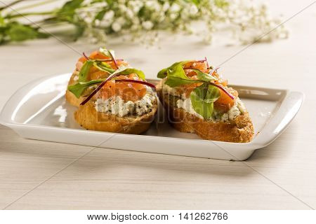 Bruschetta With Chopped Mango, Cress And Goat Cheese On Fresh Baguette