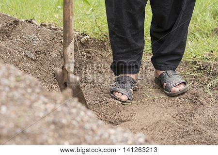 Farmer Foots With Slippers and Hoe on Work
