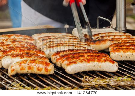 Barbecue, spicy browned sausages on the hot grill .Grill concept