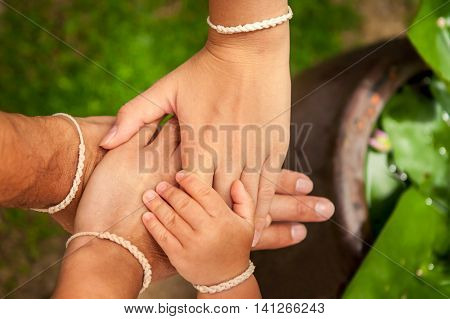Family putting their hands together. Concept for togetherness and help