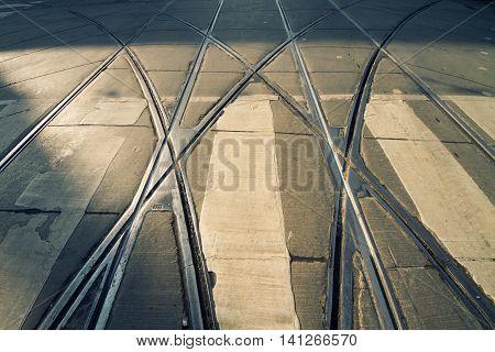 tram rails on pedestrian crosswalk; asphalt and steel on the street of canadian Toronto;