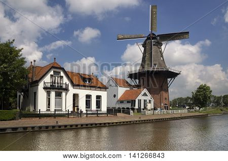 Windmill the Zwaluw along the river Dokkumer Ee in the frisian village Burdaard